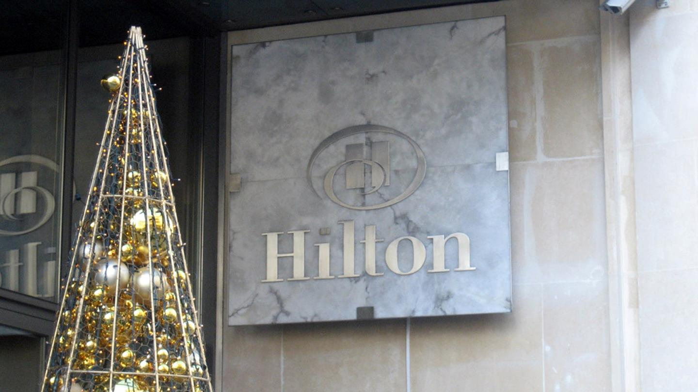 Christmas tree decorated with golden balls at Hilton Hotel entrance