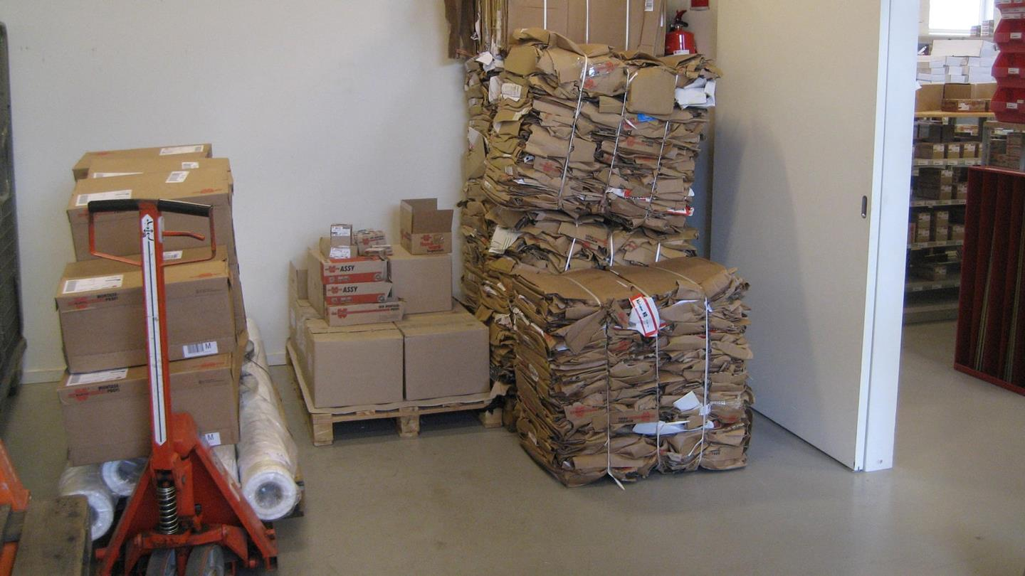 Compacted cardboard bales and boxes with goods in Würth warehouse